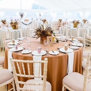 Beautiful wedding tables with bronze tablecloths