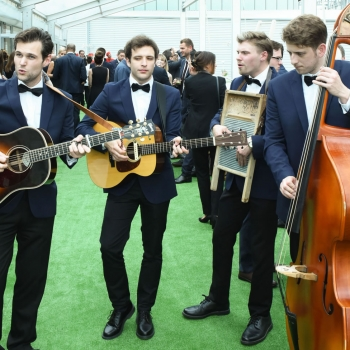 Entertainers for the liner's distinguished guests and dignitaries inside the marquee