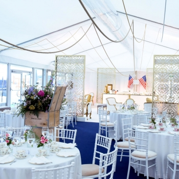 Cunard event marquee with tables and bar