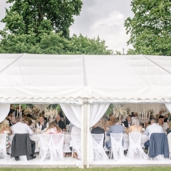 Guests seated inside marquee