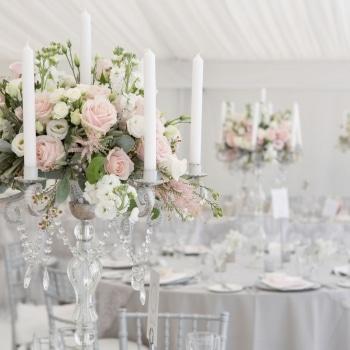 Wedding flowers inside marquee