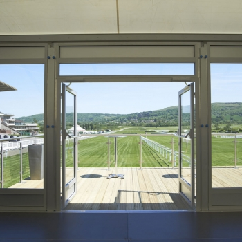 Fews Marquees used a bespoke wooden entrance featuring glass panel railings